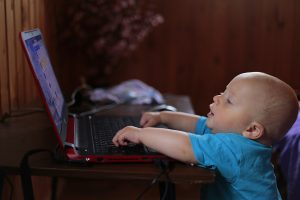 A baby checking the internet for a 508 Compliance Checklist