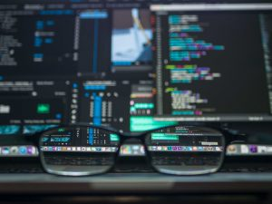 A pair of glasses sitting on a keyboard for ada website compliance