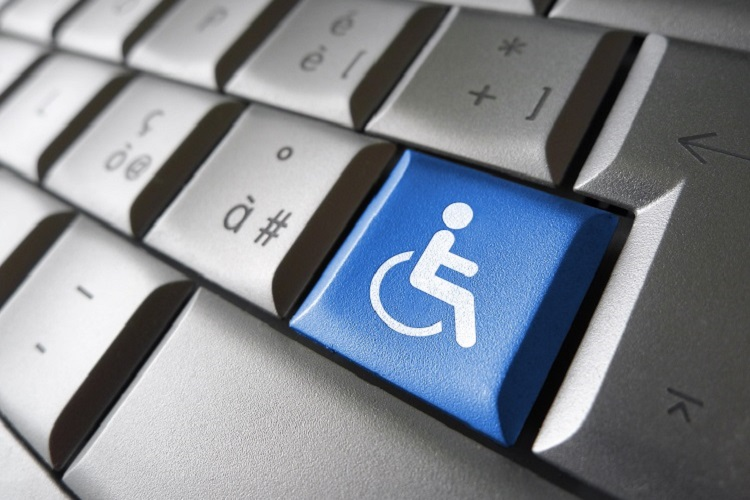 a picture of a keyboard with a wheelchair on a key
